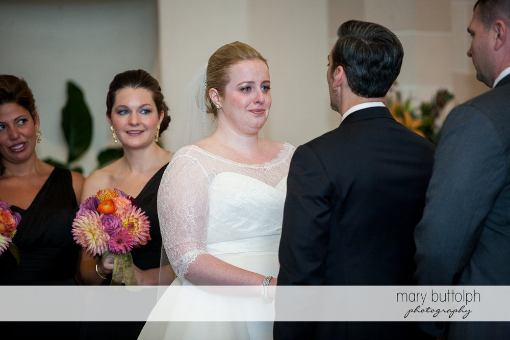 Couple face each other as the bridesmaids look on at Skaneateles Country Club Wedding