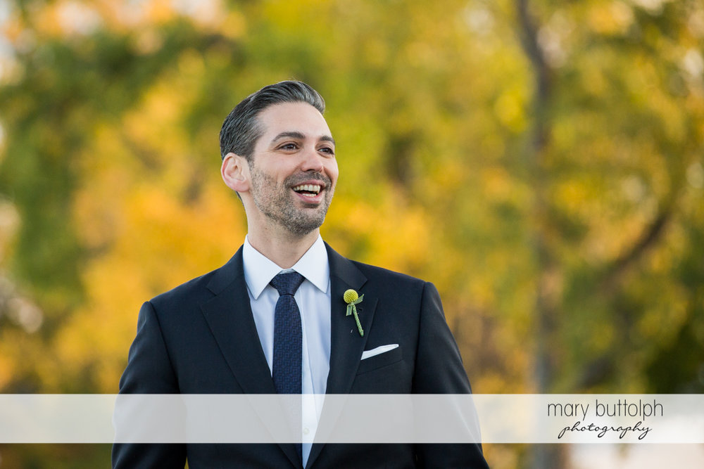 Happy groom waits for his bride at Skaneateles Country Club Wedding