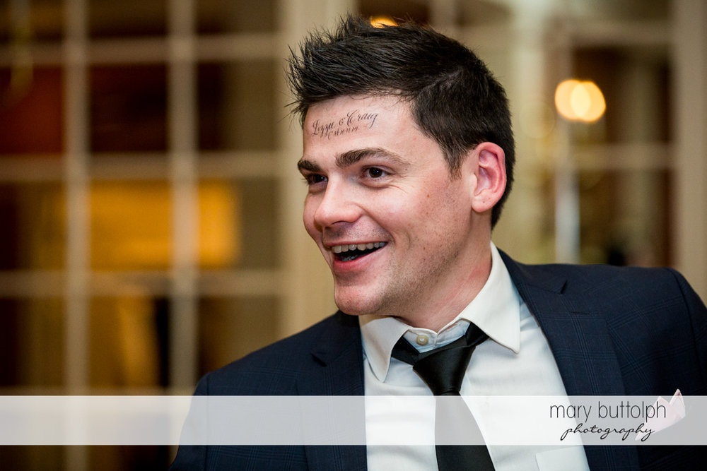 Guest with the couple's name on his forehead at Skaneateles Country Club Wedding