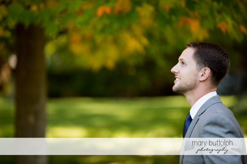 Groom waits for his bride in the garden at Skaneateles Country Club Wedding