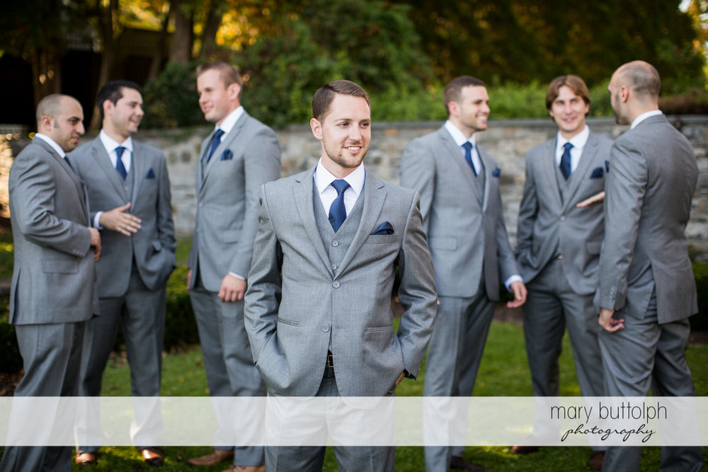 Groom and his groomsmen in the garden at Skaneateles Country Club Wedding