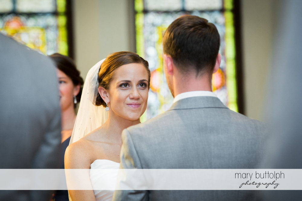 Bride faces the groom in church at Skaneateles Country Club Wedding