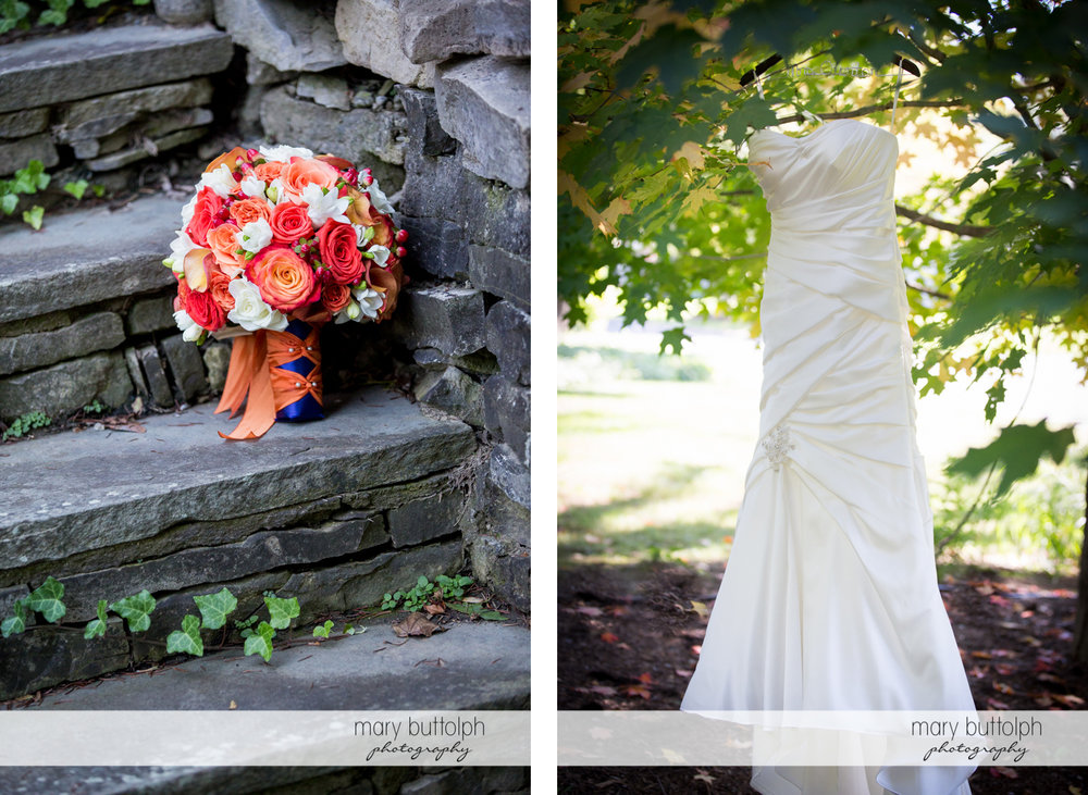 Bride's bouquet on the stone steps while her wedding gown hangs from a tree at Skaneateles Country Club Wedding