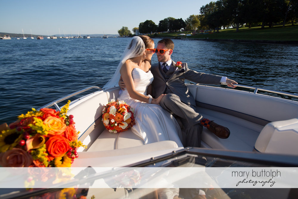 Couple share a boat ride at Skaneateles Country Club Wedding