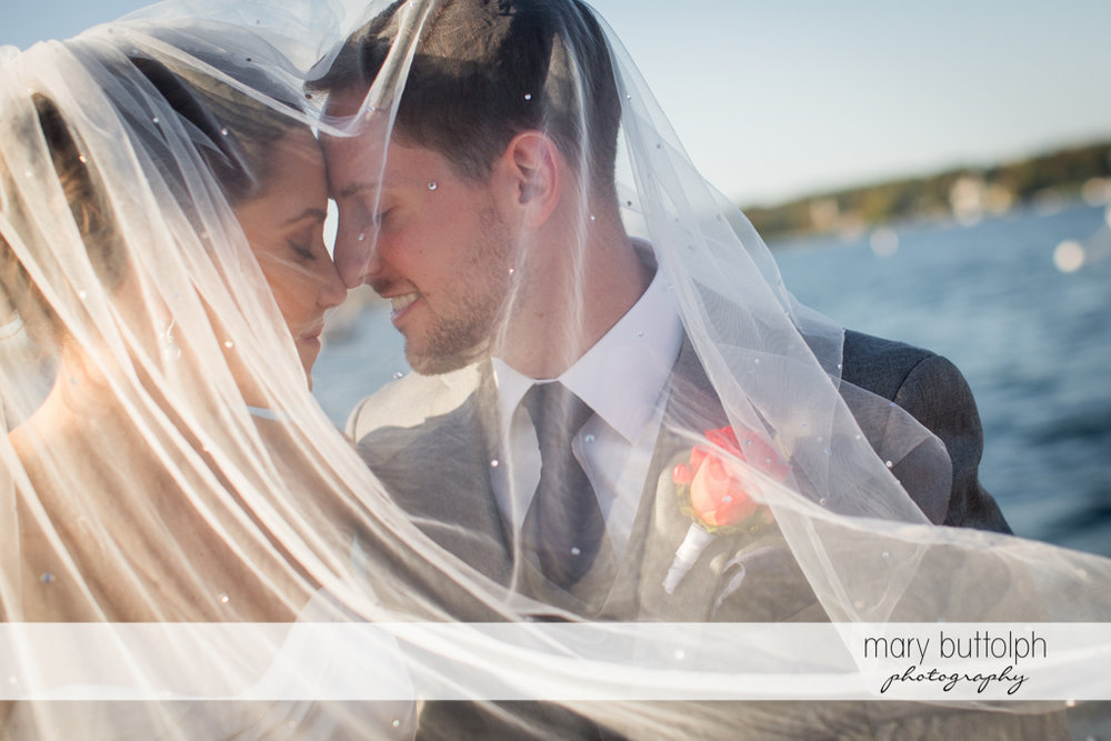 Couple rub noses under the bride's veil at Skaneateles Country Club Wedding