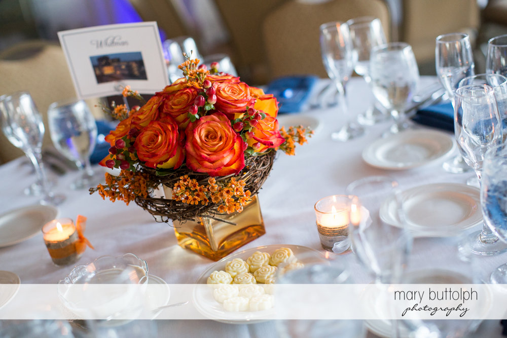 Beautiful bouquet on the table at the wedding venue at Skaneateles Country Club Wedding