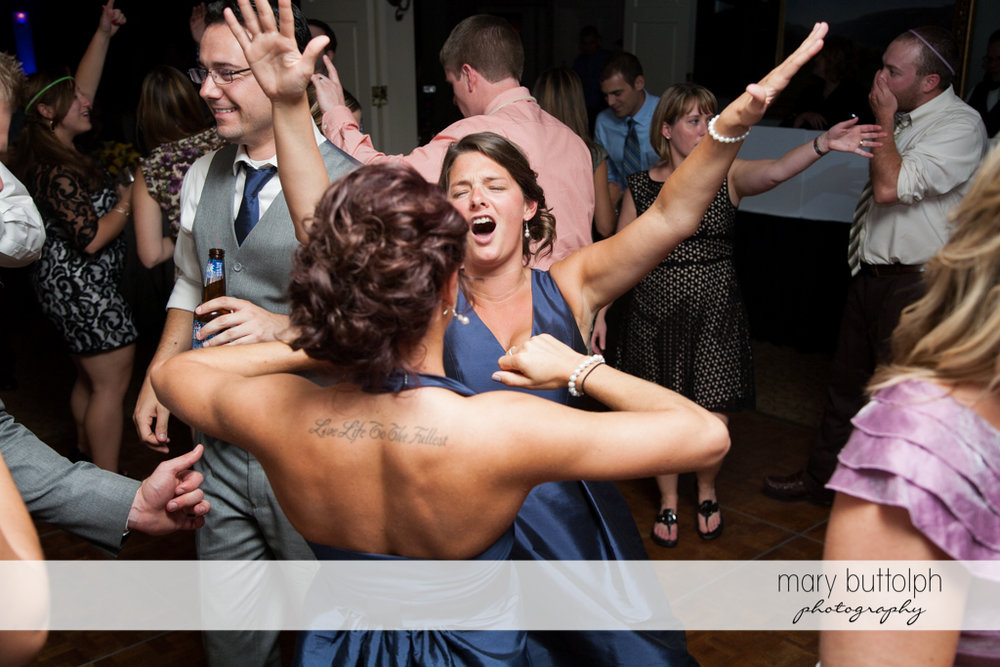 Guests dance the night away at the wedding venue at Skaneateles Country Club Wedding