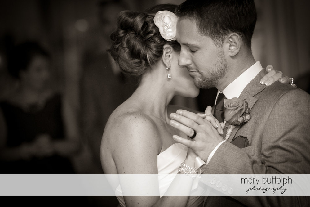 Couple share a tender moment while dancing at Skaneateles Country Club Wedding