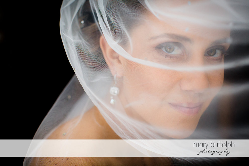 Beautiful veiled bride at Skaneateles Country Club Wedding
