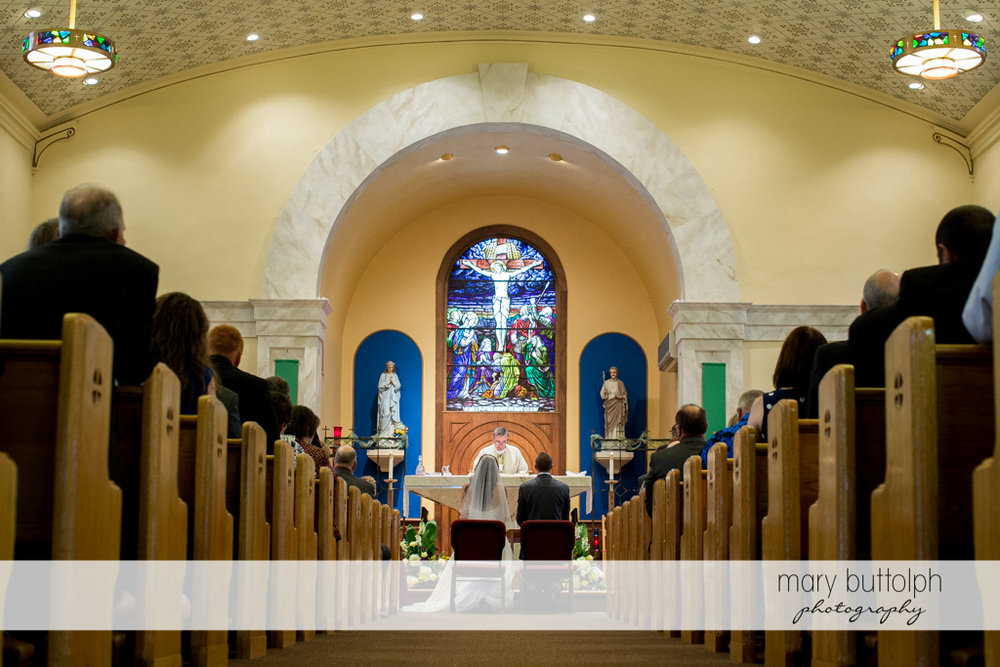 Long shot of the couple in front of the altar at the Sherwood Inn Wedding