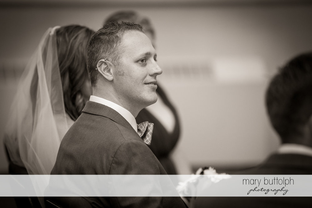 Groom looks amused in this black and white shot at the Sherwood Inn Wedding