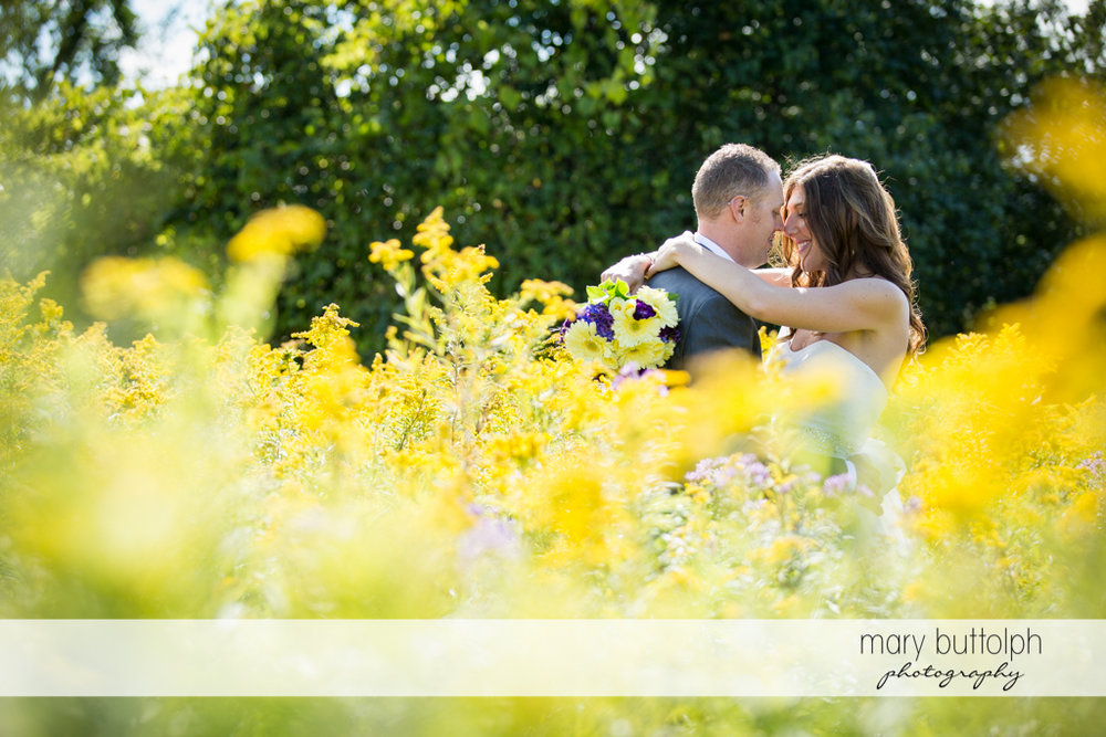 Couple share a romantic moment in the garden at the Sherwood Inn Wedding