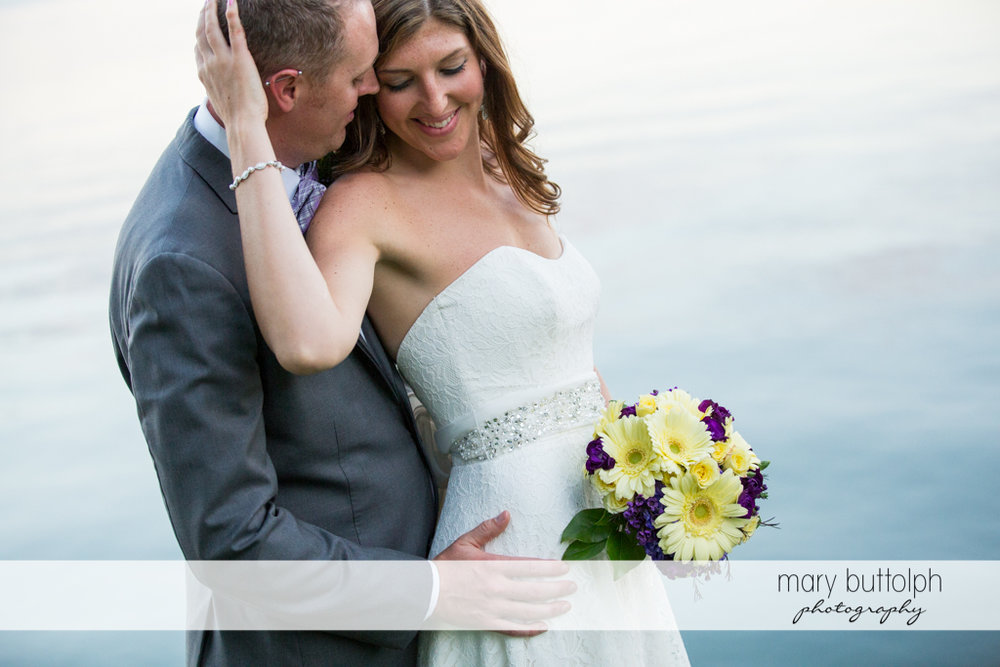 Couple pose in front of the lake at the Sherwood Inn Wedding