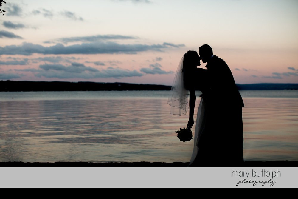 Couple enjoy their moment together by the lake at the Sherwood Inn Wedding