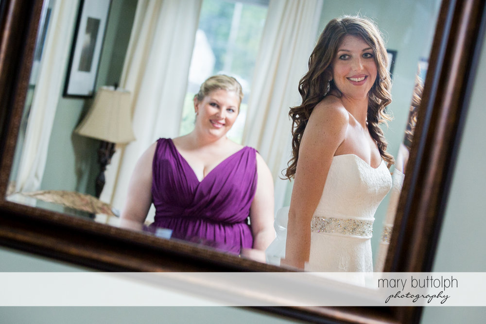 Bride's and bridesmaid's reflection in the mirror at the Sherwood Inn Wedding
