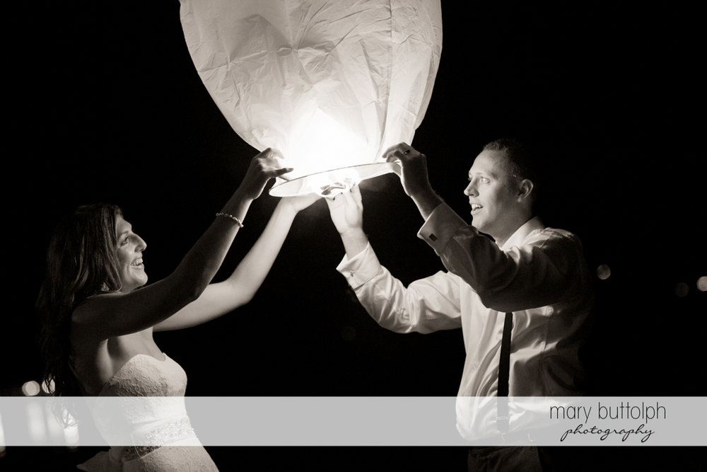 Couple hold up a paper lantern at the Sherwood Inn Wedding