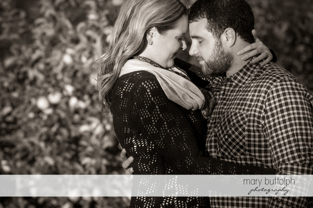 Couple in a dramatic black and white shot in the garden at Beak & Skiff Apple Orchards Engagement