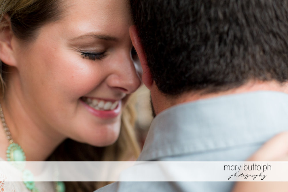 Close up shot of embracing couple at Beak & Skiff Apple Orchards Engagement