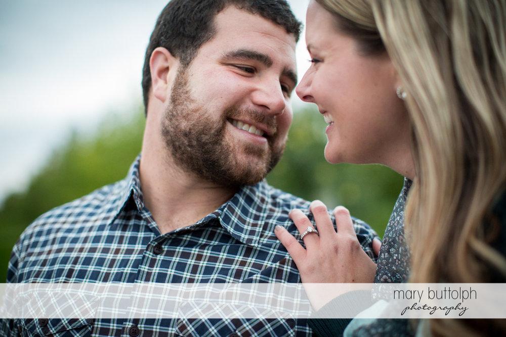Couple enjoying themselves at Beak & Skiff Apple Orchards Engagement