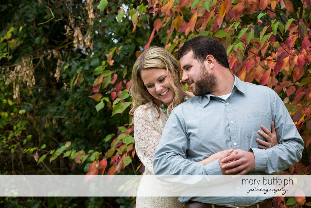 Couple cherish their time together in the garden at Beak & Skiff Apple Orchards Engagement