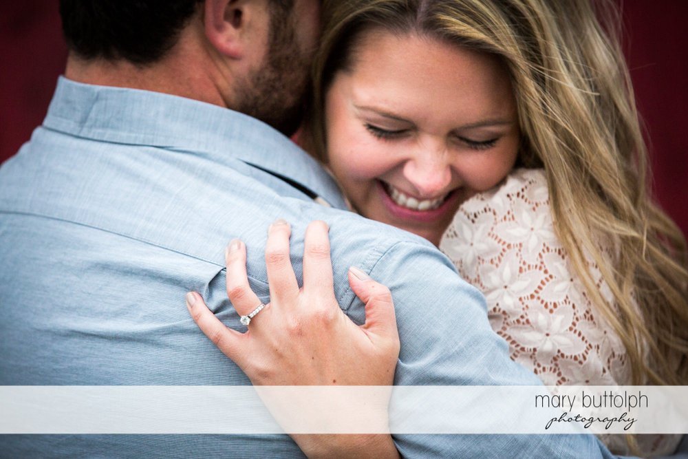 Couple in loving embrace at Beak & Skiff Apple Orchards Engagement