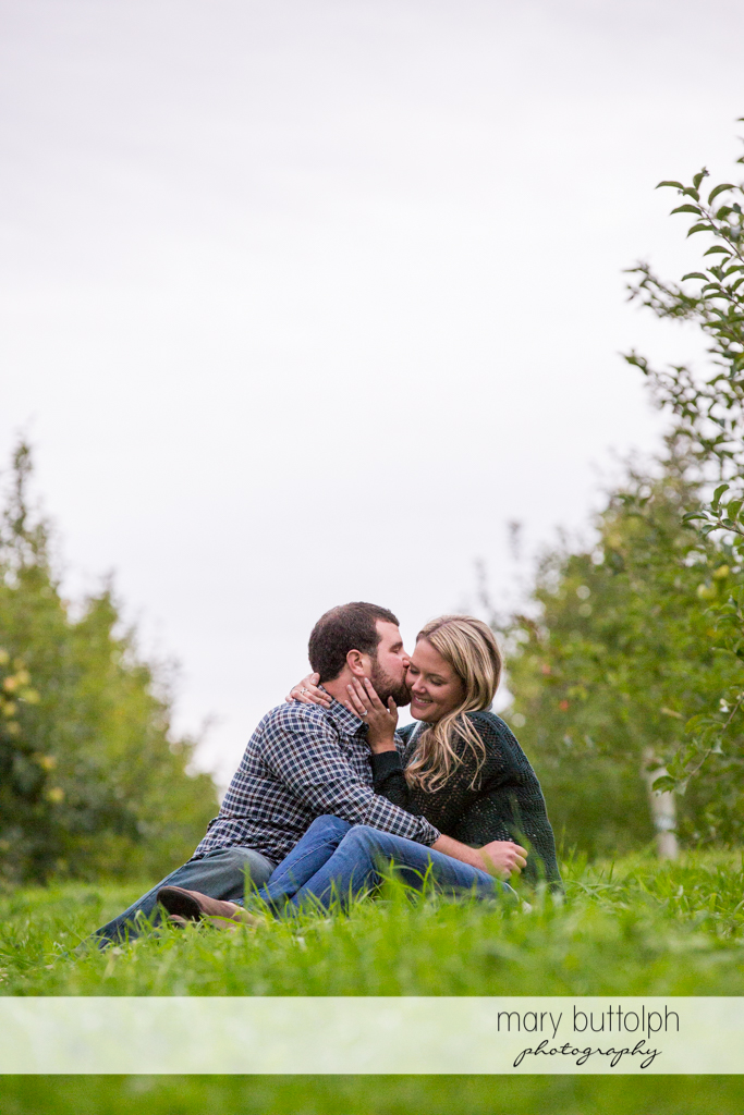 Couple relax in the garden at Beak & Skiff Apple Orchards Engagement