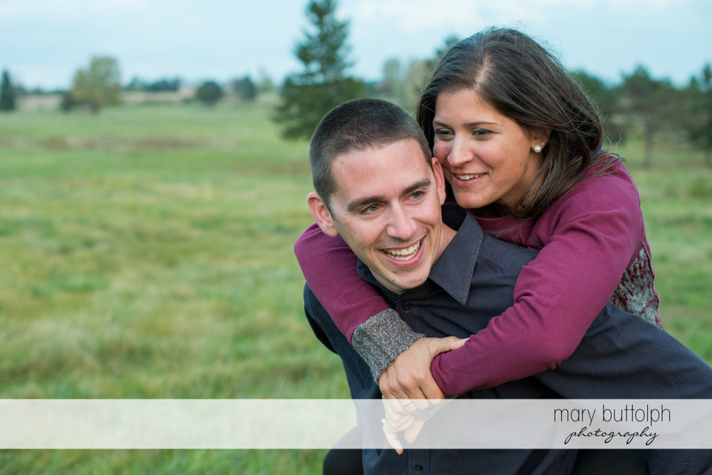 Couple horsing around in the garden at Skaneateles Lake Engagement