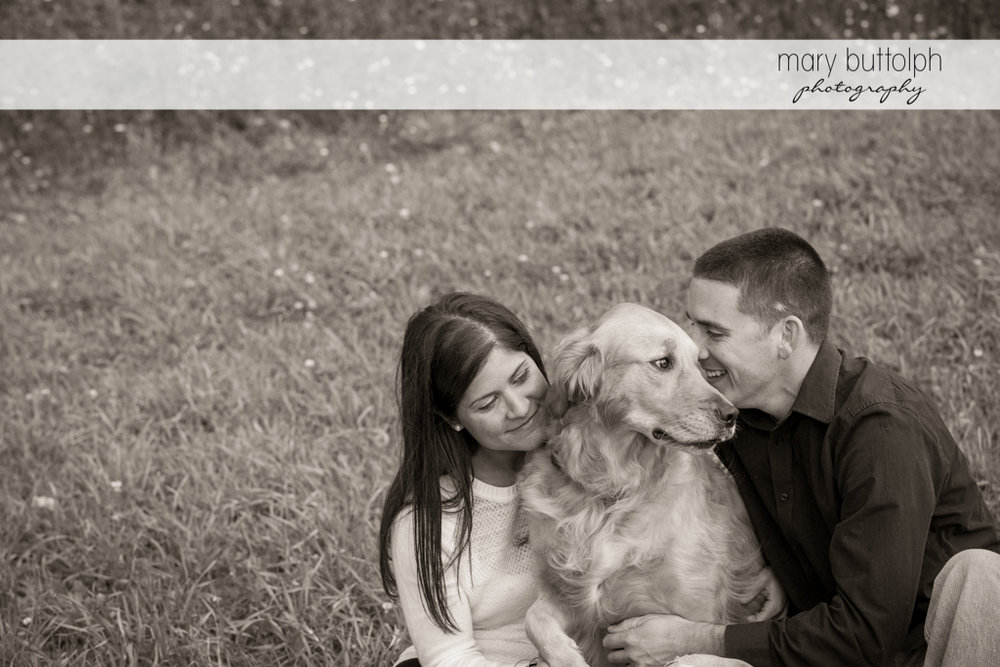 Couple with man's best friend in the garden at Skaneateles Lake Engagement
