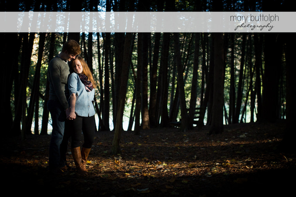 Couple holdng hands in the woods at Green Lakes Engagement