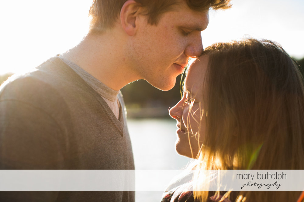 Couple stand in front of the lake at Green Lakes Engagement