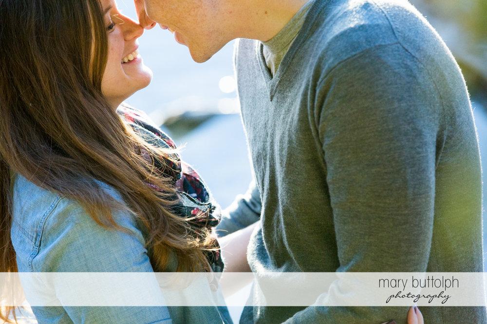 Couple rub noses at Green Lakes Engagement