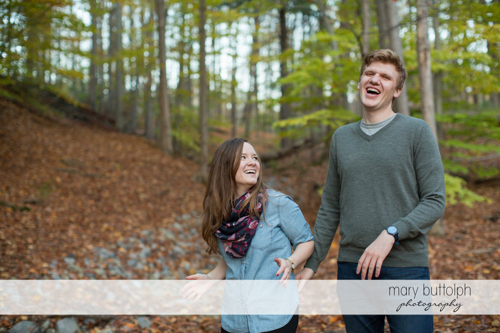 Couple share a good laugh in the park at Green Lakes Engagement