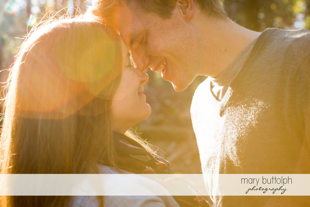 Couple enjoy the sunlight at Green Lakes Engagement