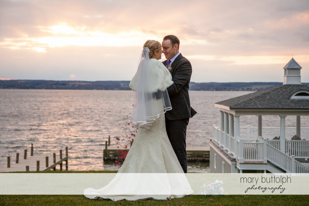 Couple pose in front of the lake at Rowland House Wedding