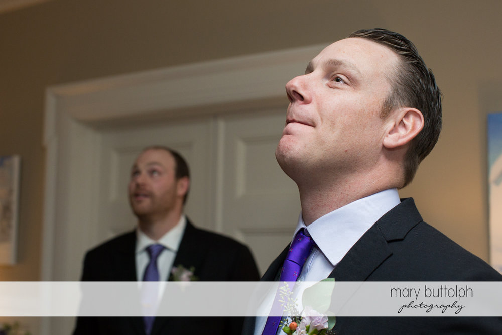 The groom and the wedding officiant wait for the bride at Rowland House Wedding