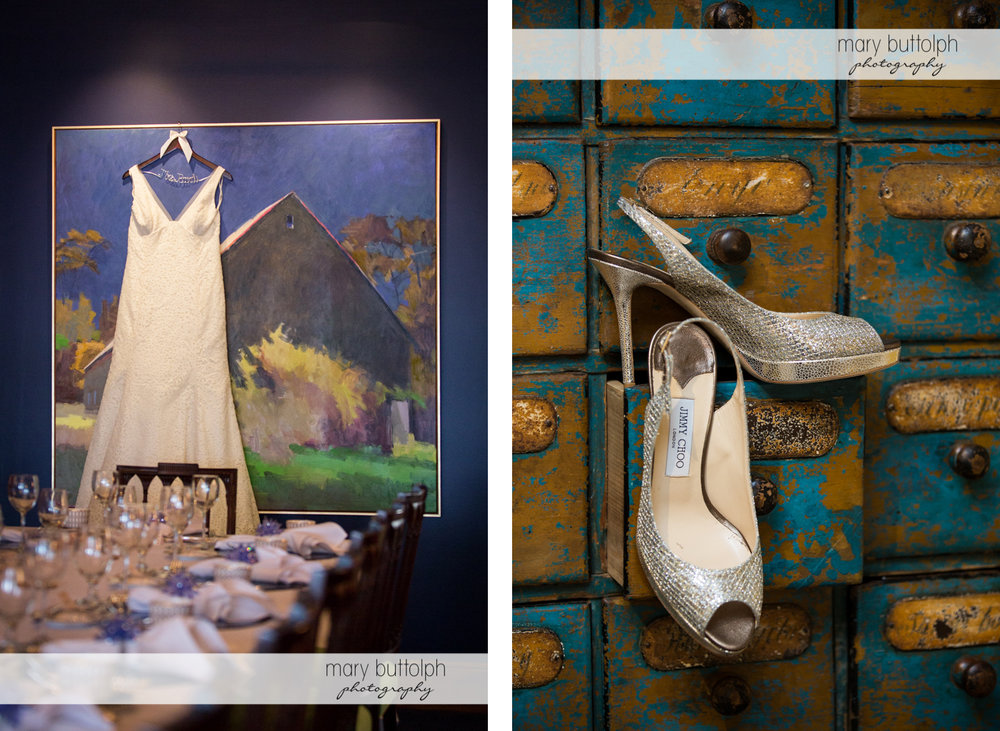 Bride's wedding gown hangs from a painting while her wedding shoes are in an old cabinet at Rowland House Wedding
