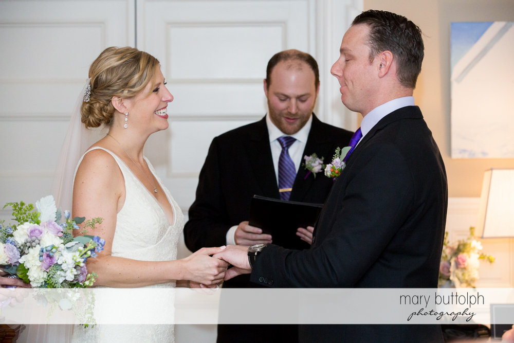 Couple exchange vows in front of the wedding officiant at Rowland House Wedding
