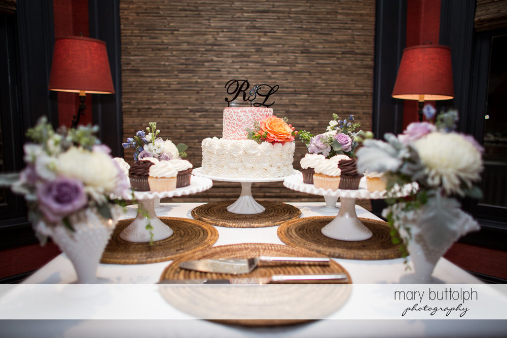 Couple's wedding cake and other pastries at the wedding venue at Rowland House Wedding