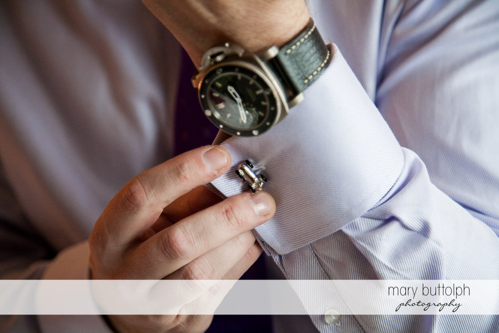 Close up shot of groom's watch and cufflink at Rowland House Wedding
