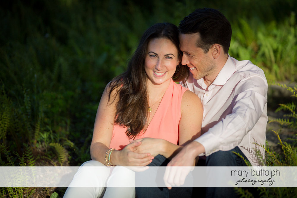 Couple sit in the garden at Cazenovia Engagement