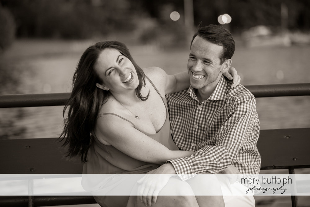 Couple in a happy mood by the lake at Cazenovia Engagement