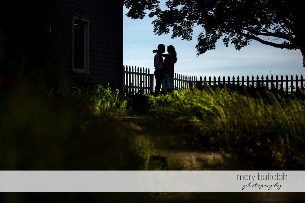 Couple hug as the sun sets at Cazenovia Engagement