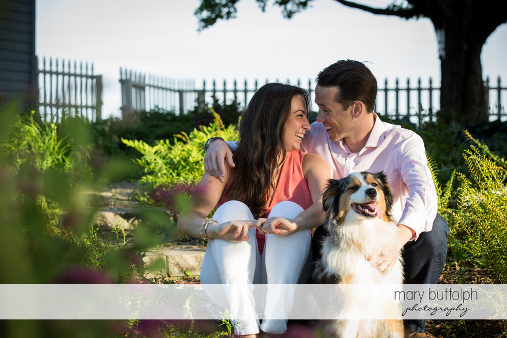 Couple take a break in the garden with their pet dog at Cazenovia Engagement