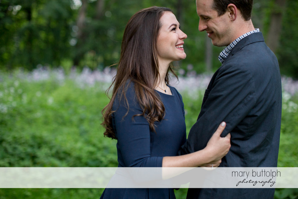 Couple pause in the park at Skaneateles Lake Engagement