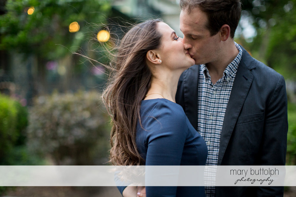 Couple express their love in the park at Skaneateles Lake Engagement