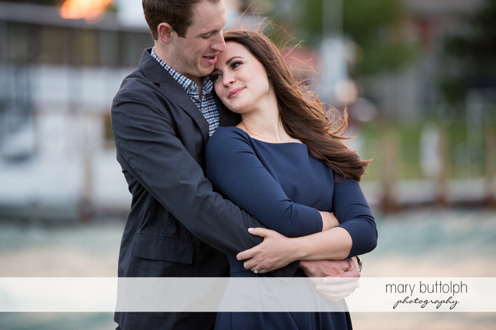 Couple share a quiet moment at Skaneateles Lake Engagement