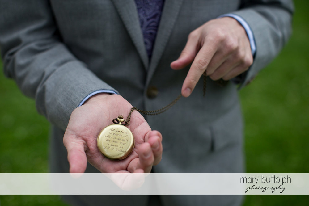 Man points to an old watch with a dedication on the back at Frog Pond Bed & Breakfast Wedding