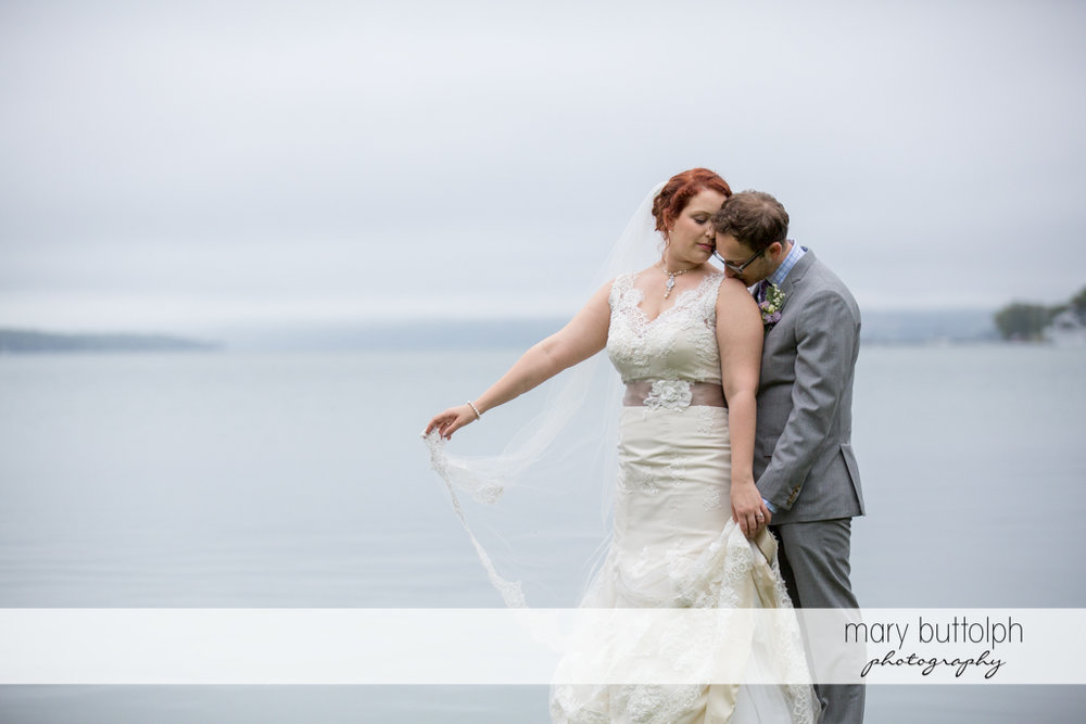 Couple get romantic near the lake at Frog Pond Bed & Breakfast Wedding