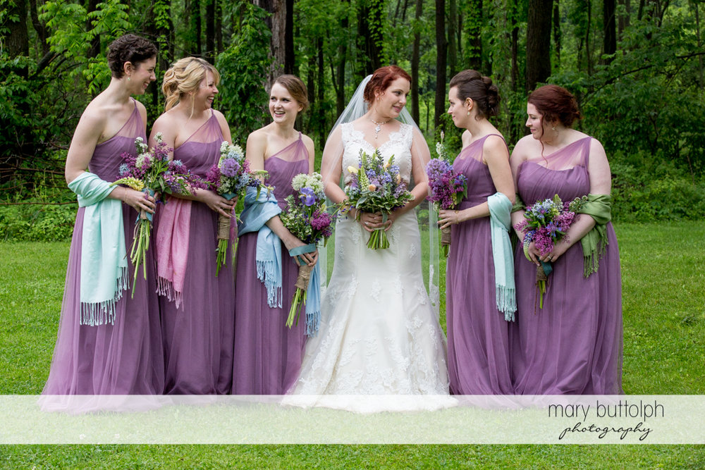 Bride and bridesmaids in the garden at Frog Pond Bed & Breakfast Wedding