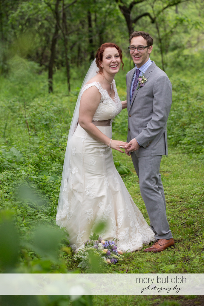 Happy couple in the woods at Frog Pond Bed & Breakfast Wedding